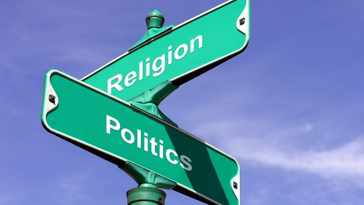 Religion and Politics intersecting road sign.