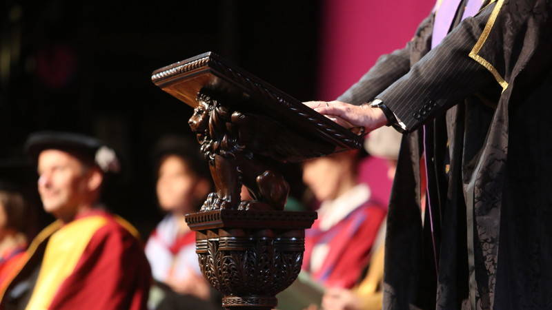 Person stood at lectern in Graduation ceremony