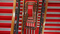 A staircase carpeted in red