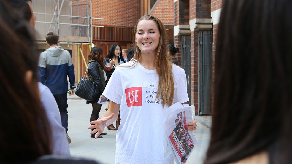 A student talking to others outside the LSE Students Union
