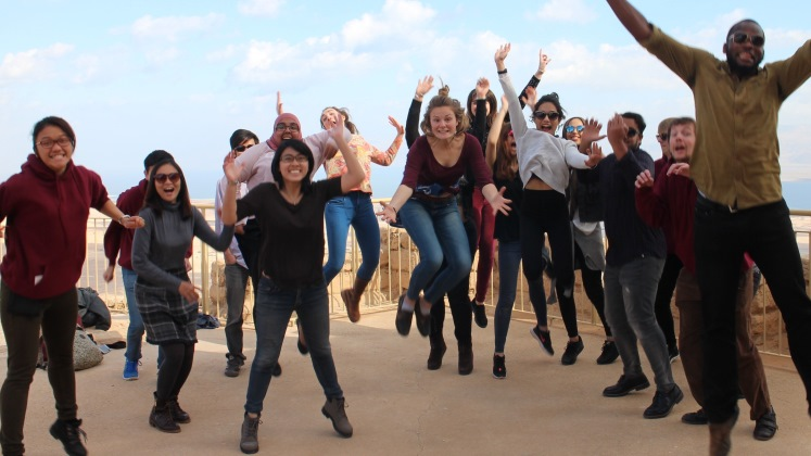 Full group picture of students jumping in the air on the Interfaith Encounter trip to Israel and Palestine.