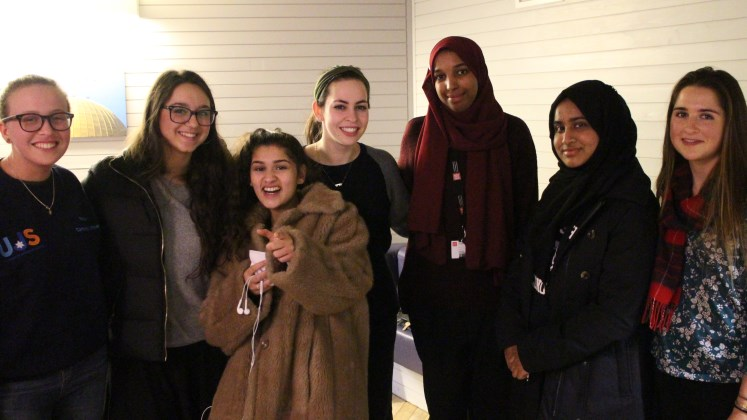 Muslim and Jewish female students standing together in the Faith Centre