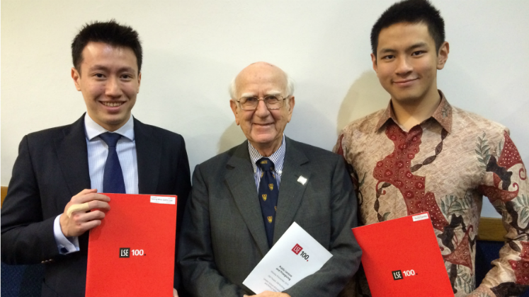 Image of Sir Robert Worcester Prize with two LSE100 prize winners