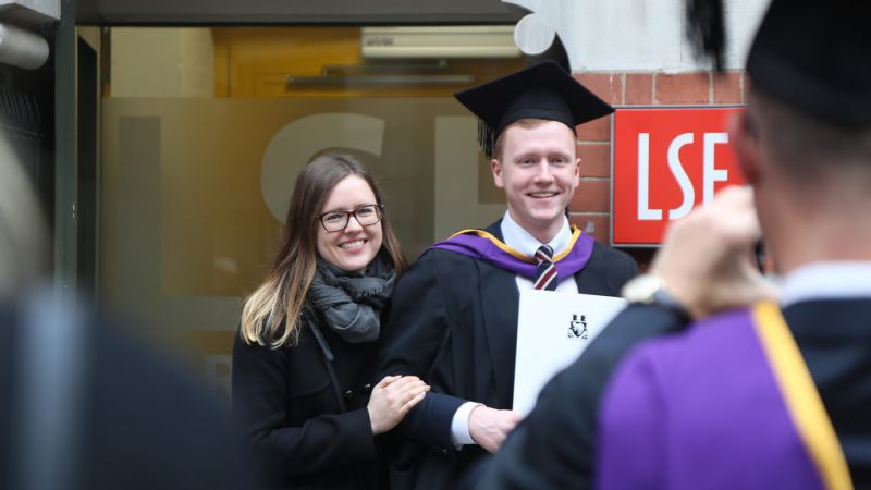 an LSE graduate posing for a photograph