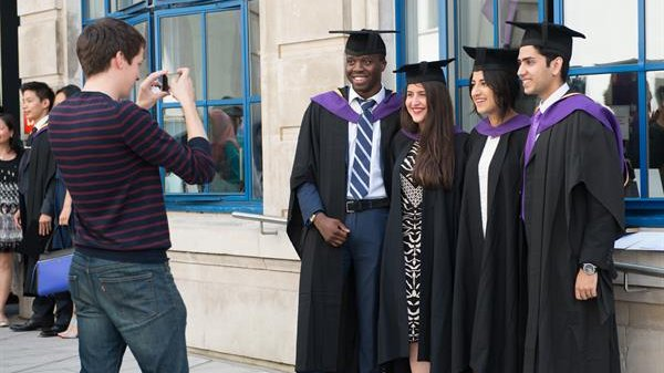 four LSE graduates posing for a photograph