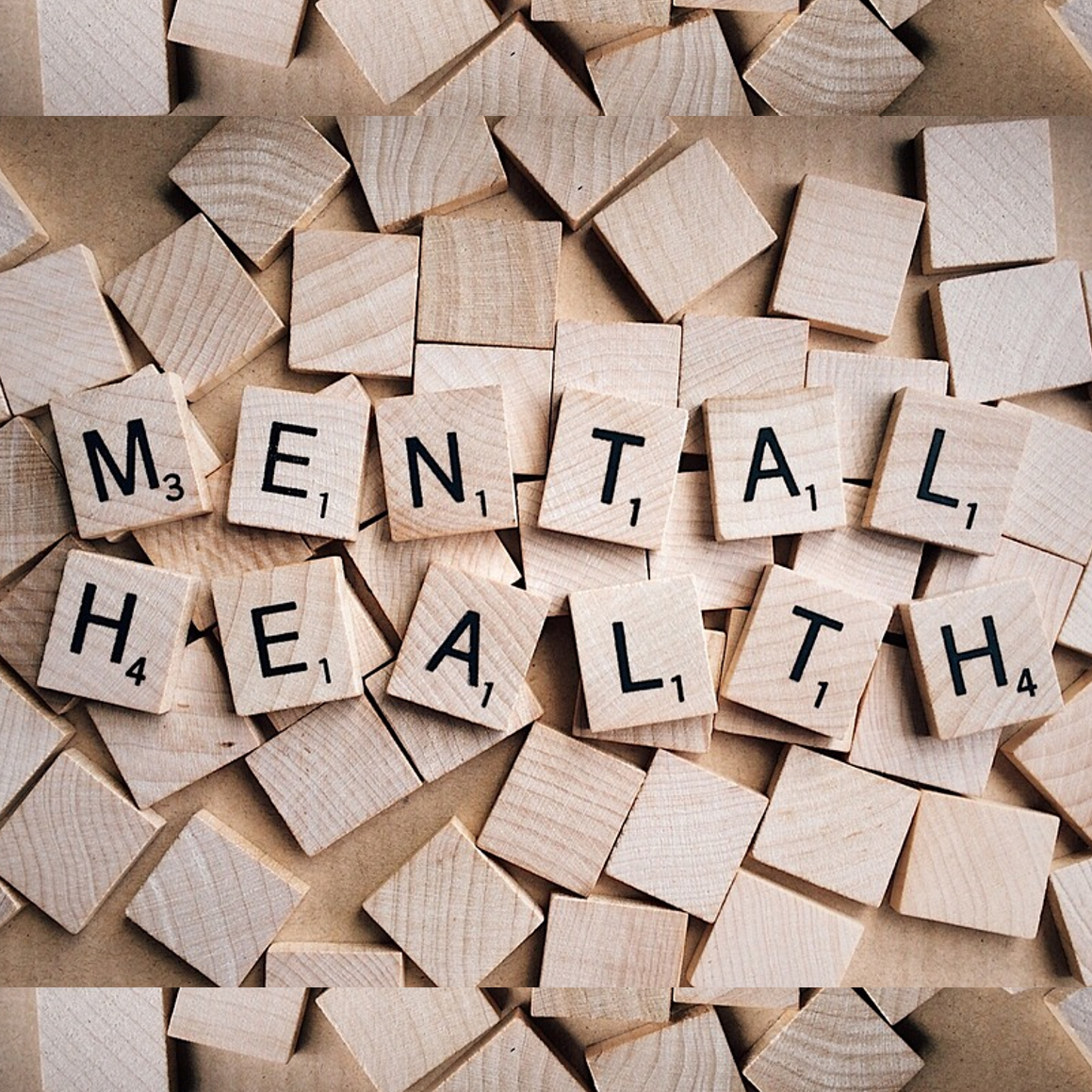 Scrabble tiles spelling out 'mental health'