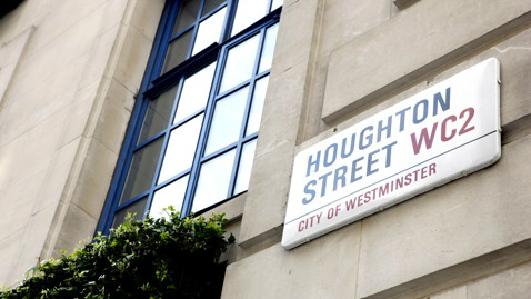 The sign for Houghton Street on the side of a building