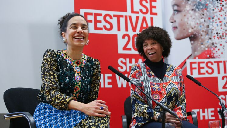 African Women Writers event speakers in front of LSE Festival branding