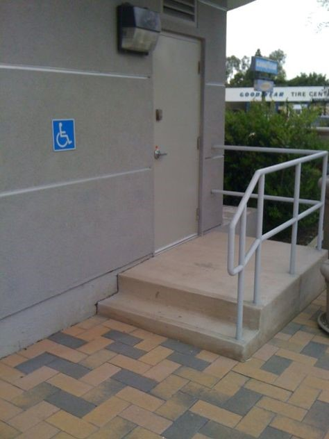 Photo of an accessible toilet with steps to the toilet instead of a ramp