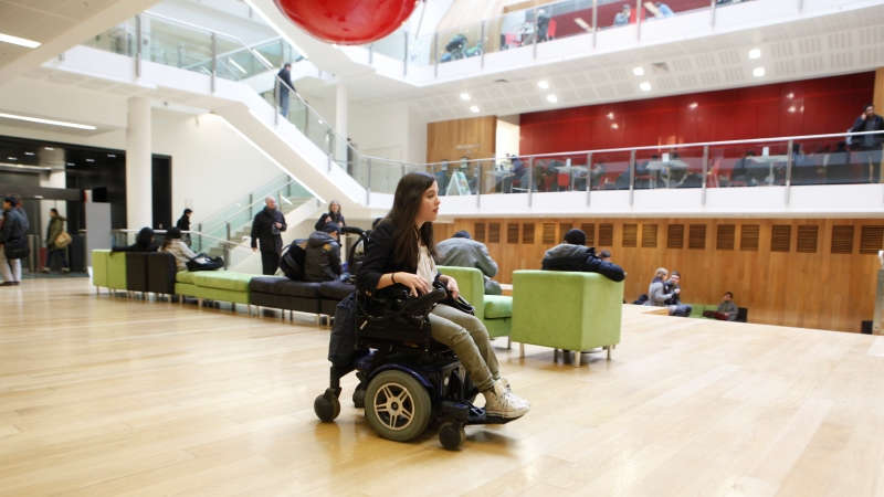A wheelchair user in the New Academic Building