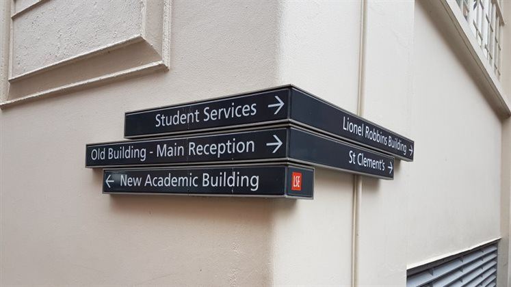 Directional signs on campus