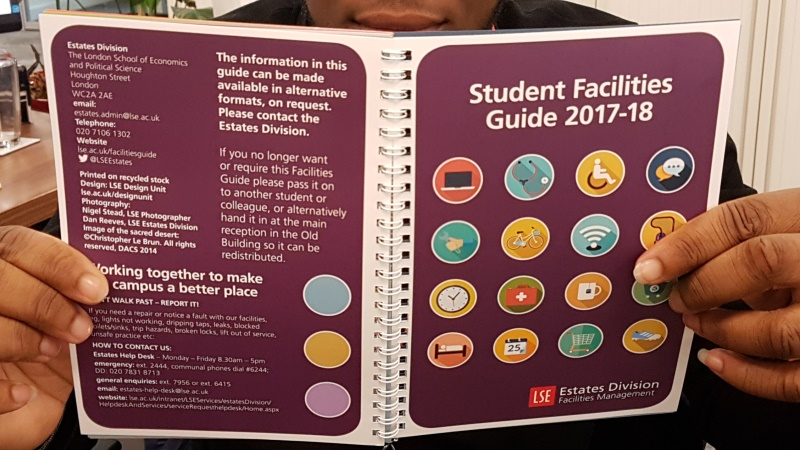 person holding guide LSE student facilities guide
